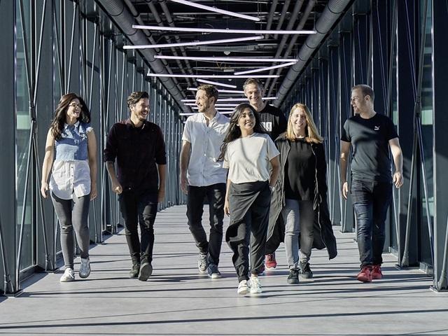 people walking on the PUMA bridge