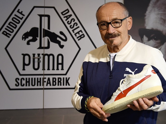 Helmut Fischer presenting a PUMA sneaker
