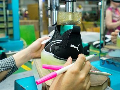 PUMA shoe and pencils