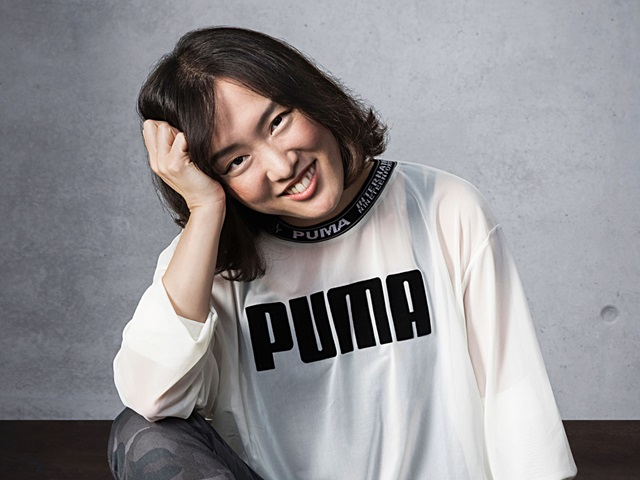Manager Cathy Hur wearing PUMA