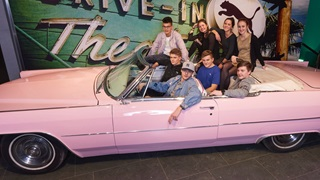 people in a pink car