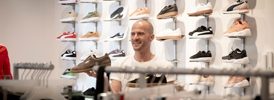 man in front of PUMA sneakers