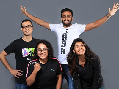 Lächelnde Mitarbeiter von PUMA Indien