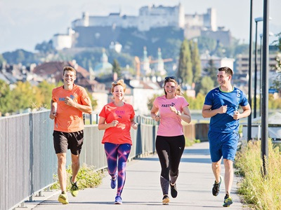 four people running in Austria