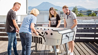 PUMA team playing table football