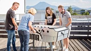 PUMA team playing table football