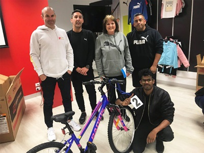 PUMA employees with a bike
