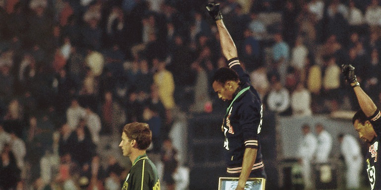 Tommie Smith raising his fist in a silent gesture