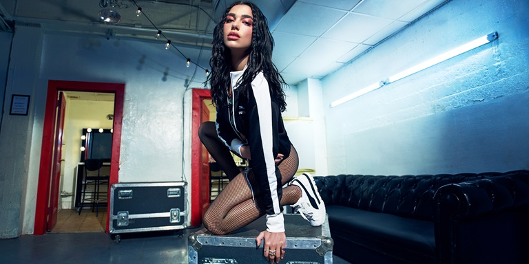 Dua Lipa on a container
